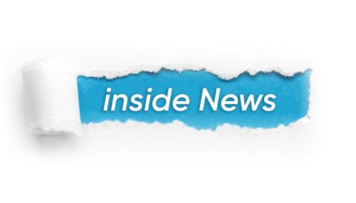 """Der Schriftzug """"inside news"""" auf einem Papier"""